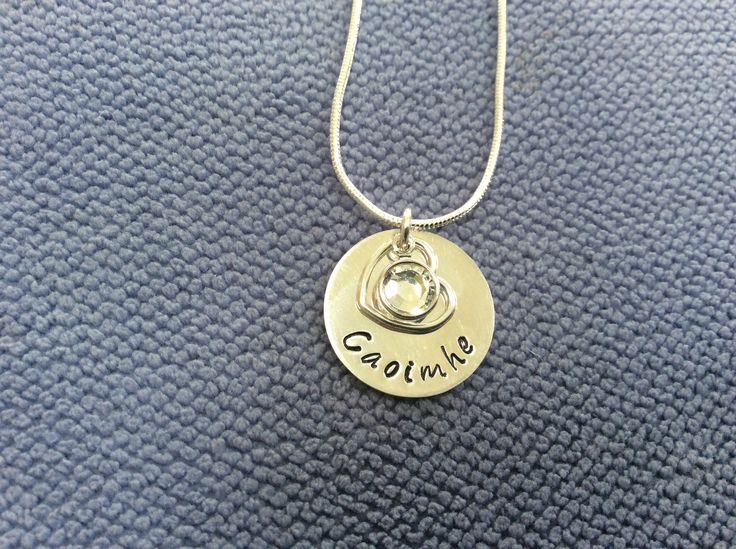 Silver stamped disc with hand stamped name, open heart and April Swarovski birthstone. €30