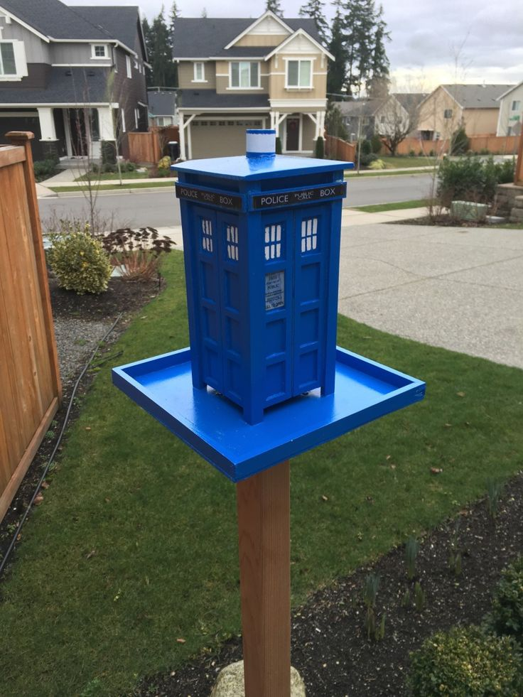 Step by step instructions on how to build a scale model Doctor Who TARDIS bird feeder with only a few simple supplies.