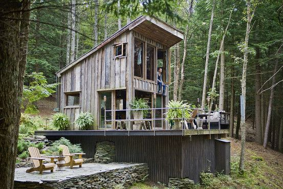 From Salvage to Shelter...In Sullivan County, N.Y., Scott Newkirk's home is small, at 300 square feet, but the large windows connect it to the outdoors.  It is built from salvaged materials.  The home, built from old, notched barn timbers feature prominently in the interior. With no electricity or plumbing, the house is primarily a summer retreat.