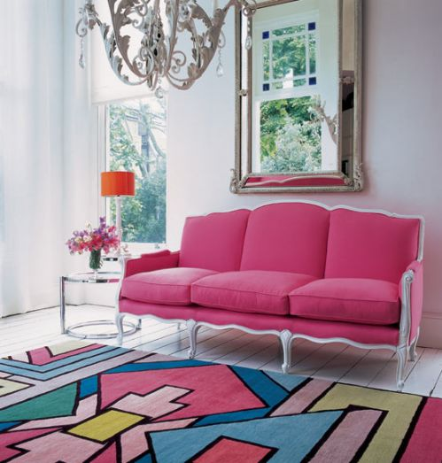 Pink sofa with abstract rug