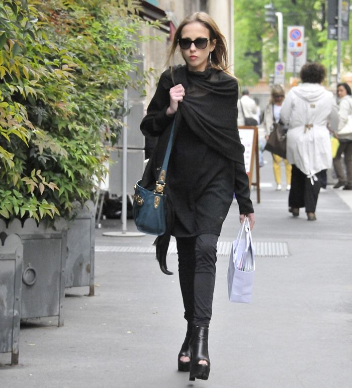 Allegra Versace, daughter of Donatella, wearing sky high heels for shopping in the city streets of Milan, Italy, on April 8, 2014