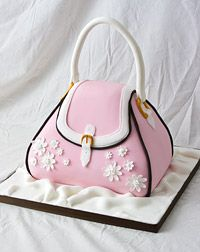 This elegant handbag has been iced with pink, white and chocolate fondant icing. Every part is edible with no wire or supports. The cake underneath is a rich chocolate sponge with an even richer dark chocolate ganache.
