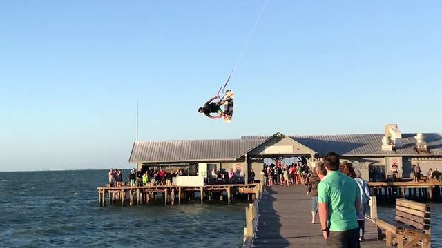 It's not unusual to see kiteboaders swinging through the skies around the Sunshine Skyway Bridge.  It's not every day that one of them catches enough air to soar over the Anna Maria Island Pier, but that's just what one wild video shows.