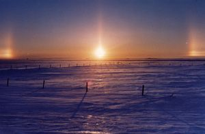 """Sun-dogs or parhelia (from the Greek """"beside the sun"""") are the two bright patches of light that are occasionally seen to flank the rising or setting sun."""