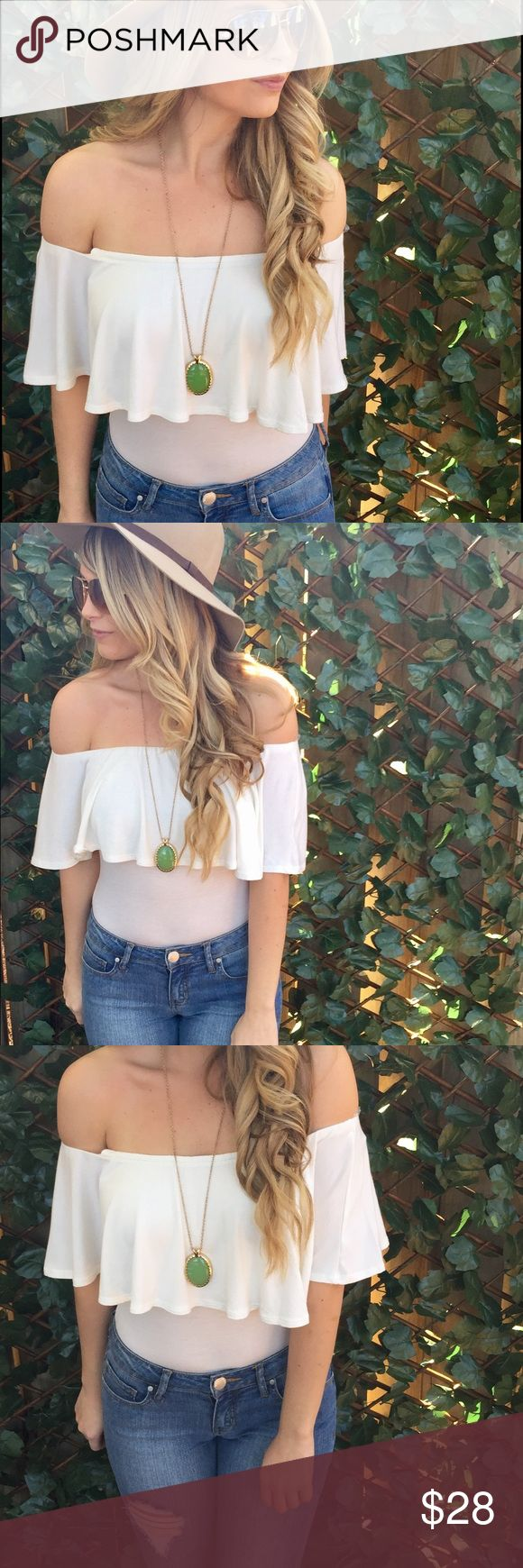 White Bodysuit This bodysuit features a off the shoulder look, button snaps and a flounce look.   -wearing size small Tops Blouses