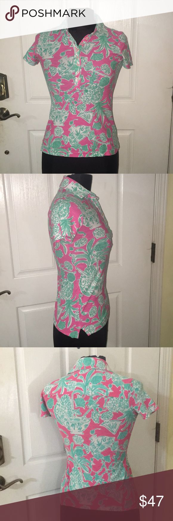 Lilly Pulitzer top Tropical pineapple and drinks with little umbrellas in green and white on a pink background Lilly Pulitzer pull over collared top. 8 button can Turn this cute top into a vneck l. Size S 100% cotton. No rips, stains, holes or tears. Cute and comfortable Lilly Pulitzer Tops Tees - Short Sleeve