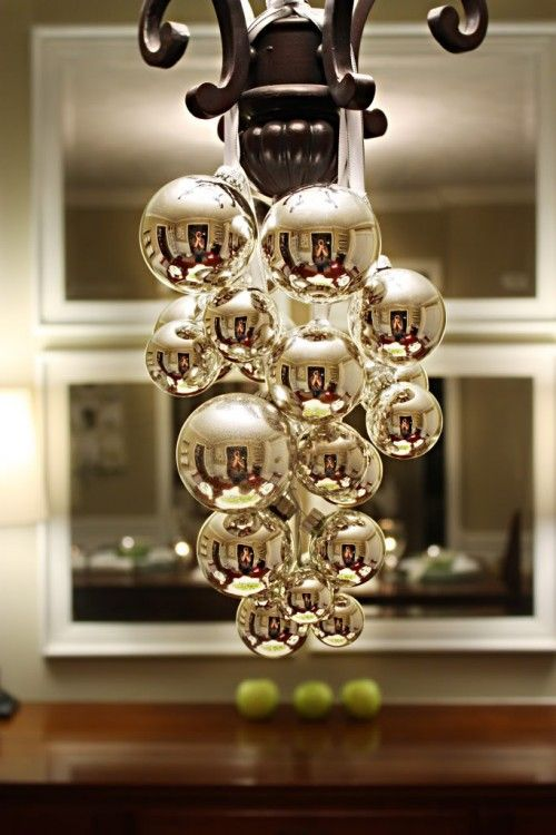 Christmas balls hanging from chandelier