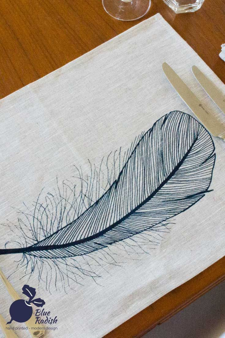 100% linen placemats. Hand printed feather design in navy ink onto natural coloured linen. Available as a set of 4.
