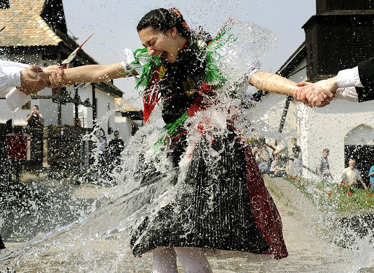 Paloc woman dressed in traditional clothing was splashed with water, which is part of the Hungarian Easter tradition, in Holloko, Hungary. (Bela Szandelszky/Associated Press)