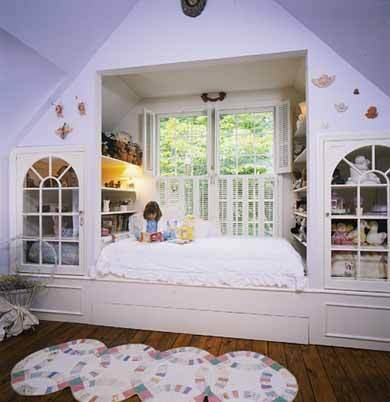 Alcove bed in attic, with lovely glass doors covering the storage areas. From Better Homes & Gardens.