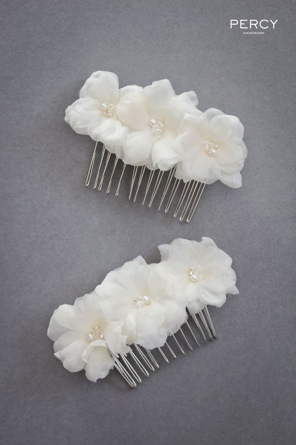 Flower hair accessories for Emilie's bridesmaids by Percy Handmade.
