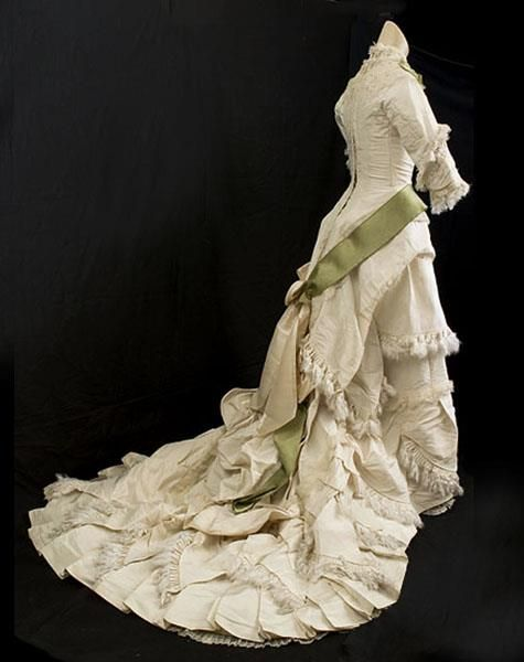 Circa 1880 Princess Line Dress: taffeta, silk faille, trimmed with delicate lace, pleated silk fringe, and satin ribbon.