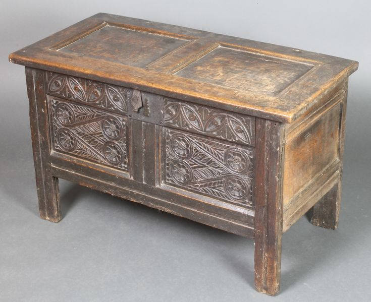 "Lot 857, A 17th/18th Century carved oak coffer of panelled construction, with iron hinges and lock, the interior fitted a candle box, 22"" 1/2""h x 37""w x 18""d, sold for £240"
