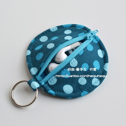 Ear Bud pouch.  (Or small mp3 player)  Little coin purse.