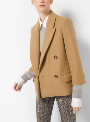 An abbreviated hem updates this modern take on the classic Chesterfield. Neatly tailored in Italy from wool-melton, this jacket is designed with crisp, notched lapels, cropped sleeves and a double-breasted button closure. Juxtapose it with sparkling trousers for a fabulous mix.