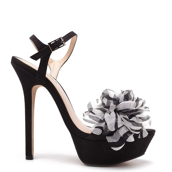 Suede high heeled platform sandals in black colour, with black and white chiffon decorative flower.