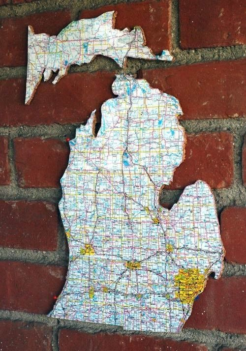 DIY: Wall Art Using Maps. Somehow, I maintain an ability to get lost anywhere & a fascination with decorating using maps.  Maps can be modern, traditional, eclectic, bold, subtle, any anything else along the decorating spectrum. This map of Michigan was mounted on cork, making it easy to put a pin in favorite destination spots.  From bbbcraft sisters on Design Sponge.