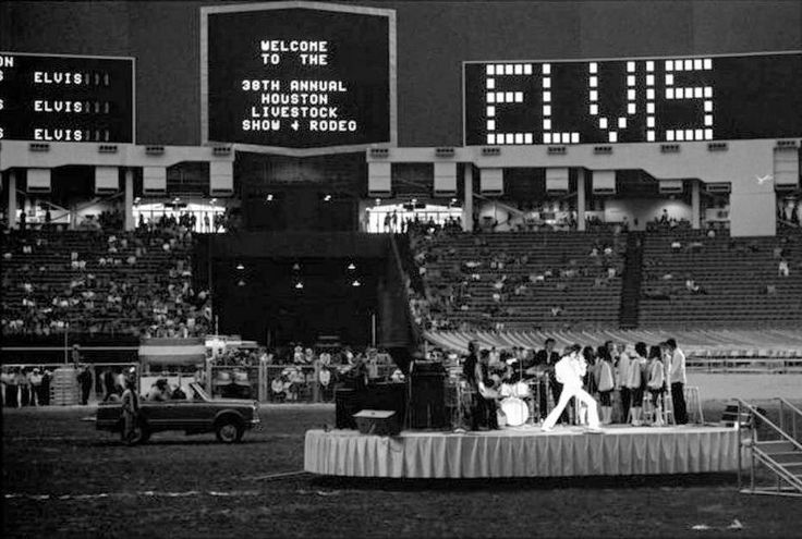 ELVIS AT THE ASTRODOME - March 1, 1970 - Elvis Presley performs at the 1970 Houston Livestock Show and Rodeo in the Astrodome. Presley made six appearances over three days at the Houston rodeo. His Saturday evening performance broke all rodeo attendance records with a crowd of 43,614.