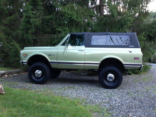 1st Generation K5 Blazer in Medium Olive with black steelies and dog dish hubcaps. So much win!
