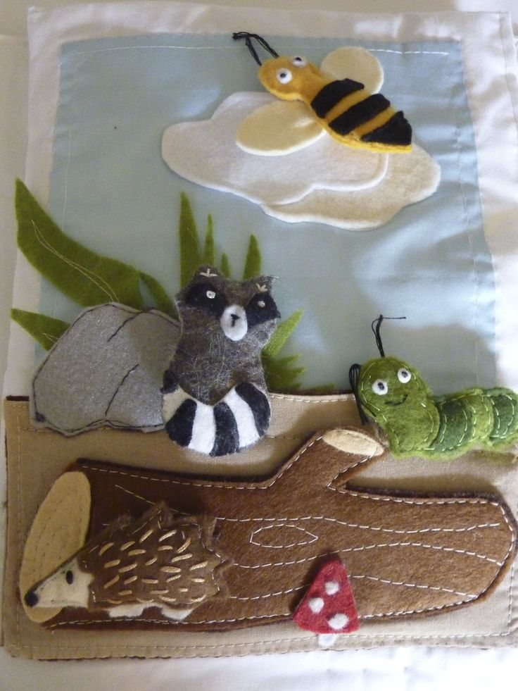 quiet book page, here are the forest felt animals! A Caterpillar,a hedgehog, a bee and a racoon.