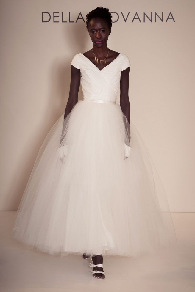 Cap sleeved V-Neck bodice with princess style tulle skirt from Della Giovanna Wedding Dresses