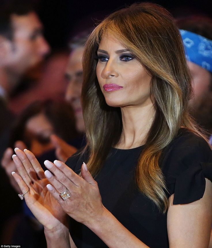 Melania, showing off some huge diamond rings, applauded her husband as he made his victory speech at Trump Towers