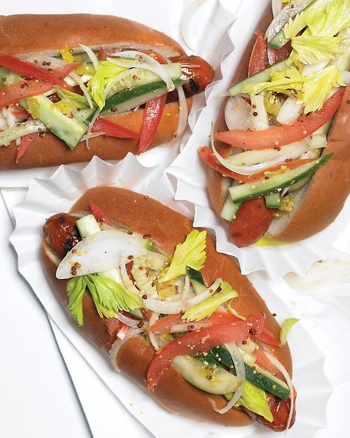 Chicago-Style Hot Dogs Recipe  1 tablespoon grainy mustard 2 teaspoons white-wine vinegar Coarse salt and ground pepper 1/4 sweet onion (such as Vidalia), thinly sliced 1 Kirby cucumber, cut into thin strips 1 tomato, halved, seeded, and thinly sliced 1/2 cup celery leaves 2 tablespoons chopped sport pepper or peperoncini 4 beef hot dogs 4 hot dog buns, grilled 4 pickle spears Relish