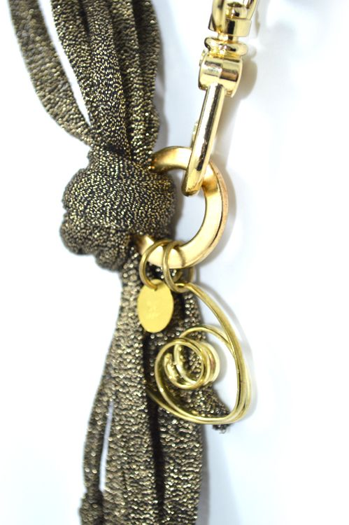 Black and gold metallic cord decorated with gold brass tubes and heart.