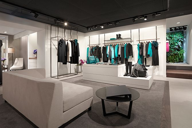Laurèl store design in Munich by eins:33 using massive amounts of Kvadrat textiles, Kvadrat Soft Cells and Philips luminous textile panels. The overall impression creates the atmosphere of an individually designed concept store with a strong idea of curatorship.