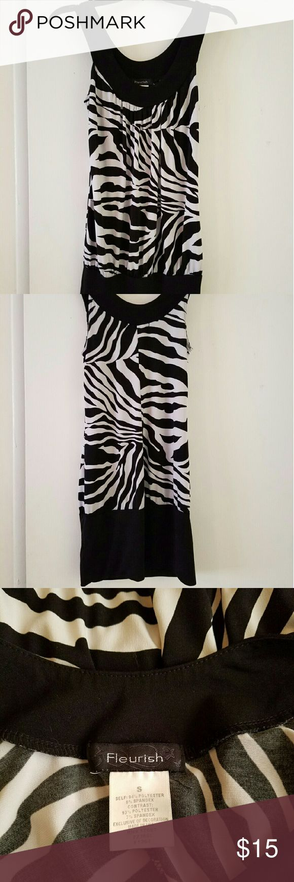 Fleurish mini dress Black and white zebra pattern mini dress. Can also be worn as a tunic top. Excellent condition,  measurements available upon request. Dresses Mini