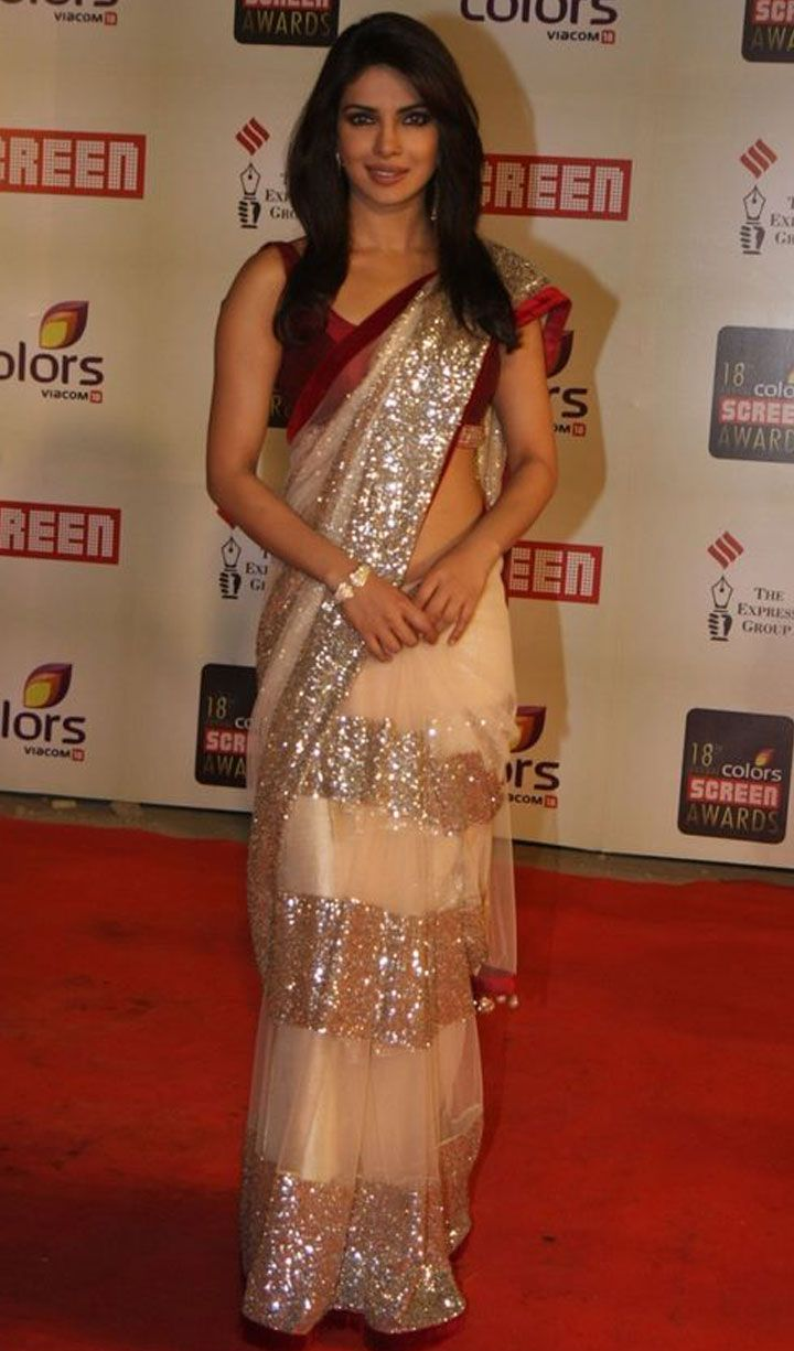 Beige sequined Manish Malhotra sari with a red velvet blouse.