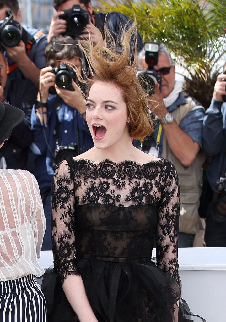 Emma Stone faced the windy weather at the 2015 Cannes Film Festival with a giant smile.