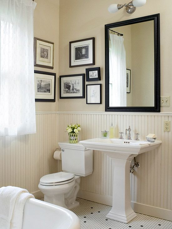 This is the size of our bathroom including the woodwork, but with a small built-in tub. I like creamy woodwork, black n white framed art, floor, soft white curtain, framed mirror, pedestal sink, toilet paper holder,