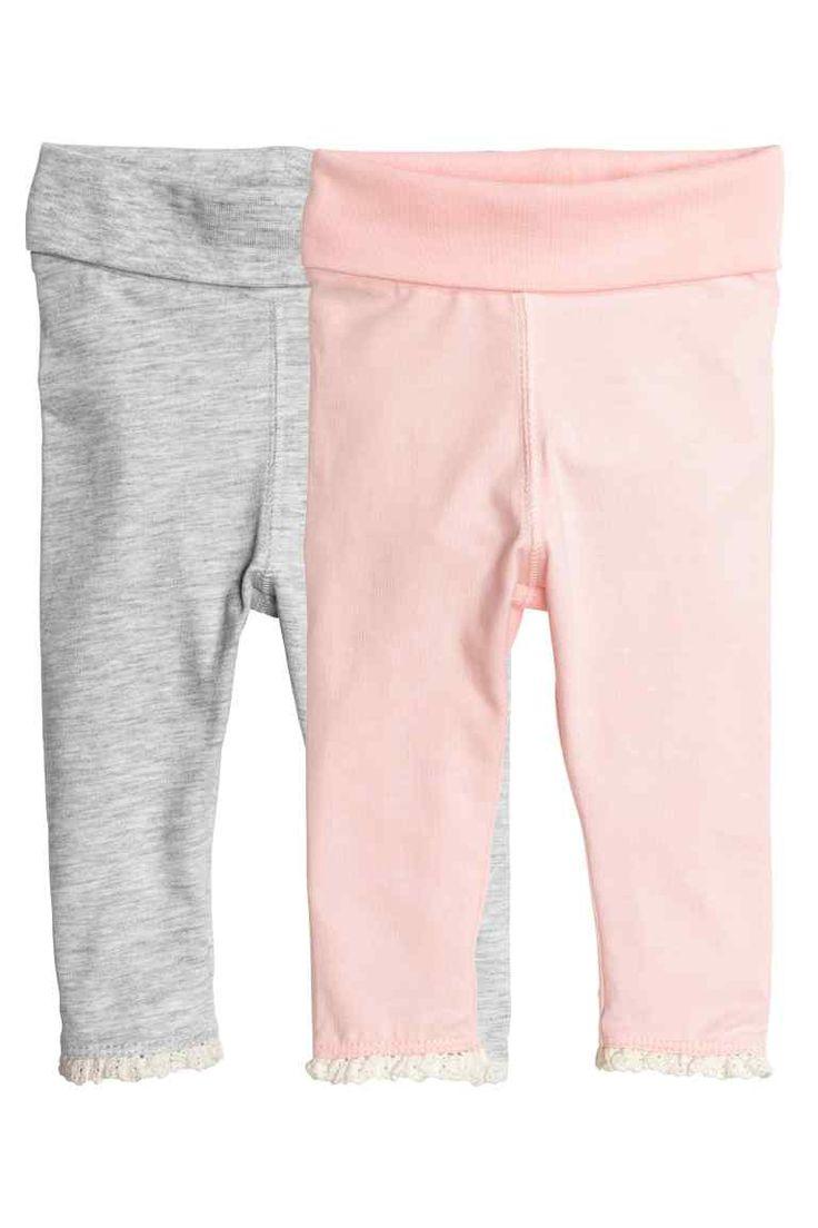 Lot de 2 leggings en jersey: CONSCIOUS. Leggings en jersey souple de coton bio. Large bande rapportée repliable à la taille et bord en dentelle en bas de jambe.