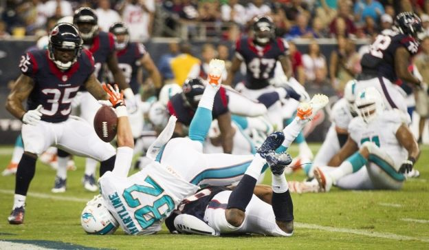 (Brett Coomer / Houston Chronicle) Dolphins wide receiver Brian Hartline has a pass knocked away by Texans defensive back Brandon Harris.