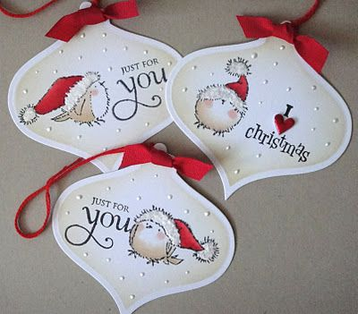 Christmas tags ... ornament ... adorable bird in a Santa Hat ... like the use of Perfect Pearls for snow flakes & fluffy parts of the hat ...