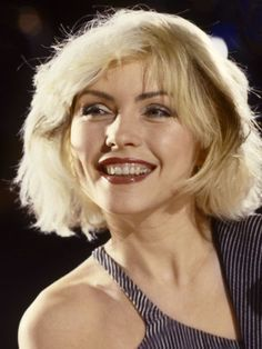 """<> MEDIUM Debbie Harry, 1979 © redferns/getty images [Deborah Ann """"Debbie"""" Harry (born July 1, 1945) is an American singer-songwriter and actress, best known as the lead singer of the new wave and punk rock band Blondie.]"""