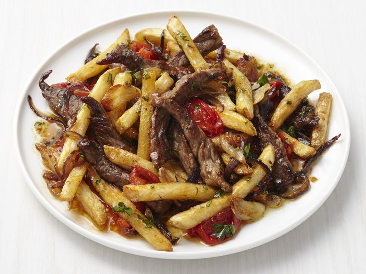 Get this all-star, easy-to-follow Beef Stir-Fry with French Fries recipe from Food Network Magazine.