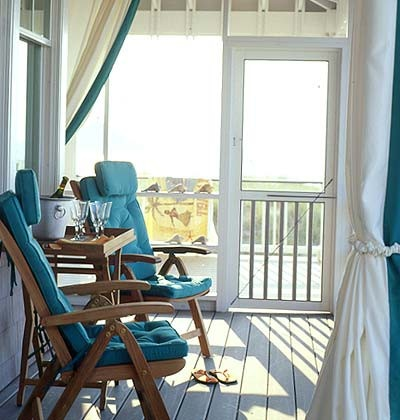 Have a chair and not a care on this beautiful beach porch.