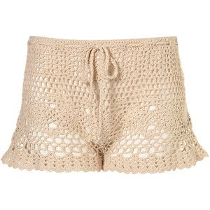 OMG. DIY Crocheted shorts...Made out of a thrift store crocheted top. VERY, cute and nifty. I love this idea, I will be making these for cover shorts over a bathing suit. Very chic! <3