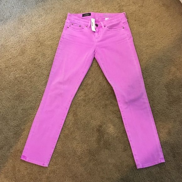 """NWT J.Crew toothpick jean in neon violet Been sitting in my closet unworn and too big for me now. NWT. Neon violet skinny jeans size size 28. The toothpick gets a jolt of color thanks to a careful garment dye that creates a pitch-perfect hue. Sits lower on hips. Slim through hip and thigh, with a skinny, cropped leg. Cotton/viscose with a hint of stretch. 28"""" inseam. 11 5/8"""" leg opening (based off size 28). Traditional 5-pocket styling. Machine wash. J. Crew Jeans Skinny"""