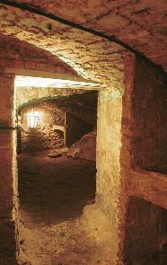 underneath the city...the edinburgh vaults  An excellent tour worth taking.  You enter through the old city chambers.