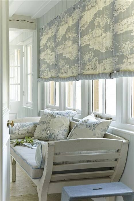 Nice use of roll up blinds lined with contrasting fabric