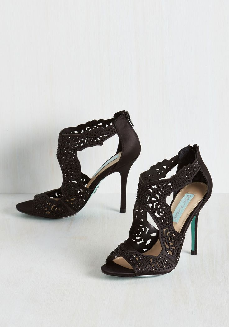 Whatever opulent occasion awaits, you know these black heels by Betsey Johnson will be with you during your grand entrance. Alongside an array of floral-inspired cutouts, dark faux stones shine atop satin uppers, giving these stilettos a luxe look that was made for your most spectacular moments.