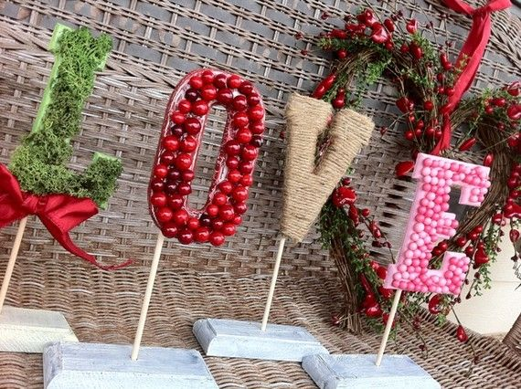 Love Letters - Glue on your favorite items onto wooden letters. #Valentines