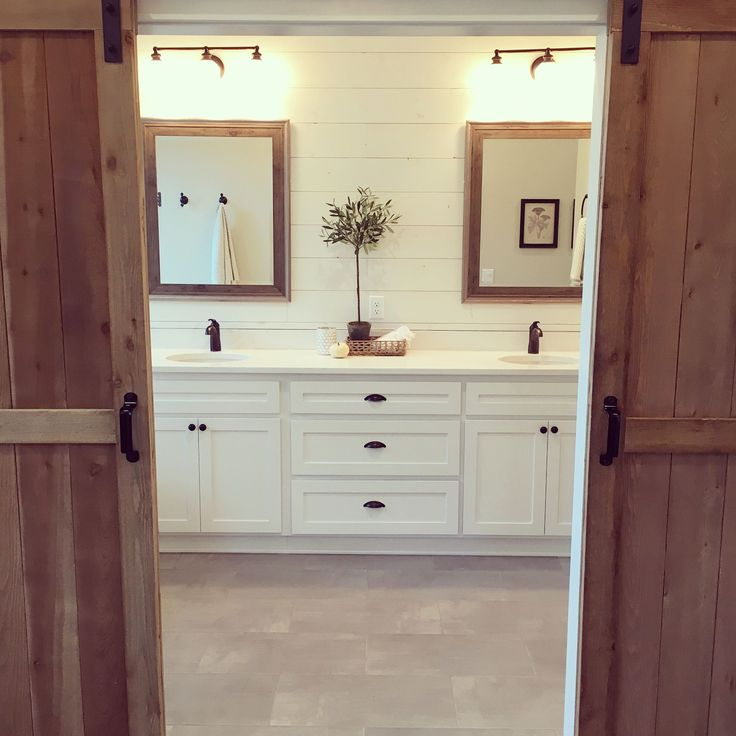 Double barn doors leading to the master bath? Yes please! The shiplap, wood tones, and clean & simple Quartz countertops lend beautifully to the modern farmhouse look.