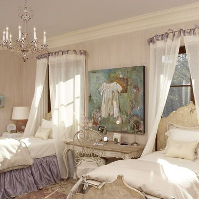 not exactly my style, but love the curved curtain rod hung over the bed with tab top curtain panels used as a canopy.