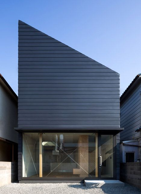 Glass-fronted Japanese home featuring a steeply angled roof