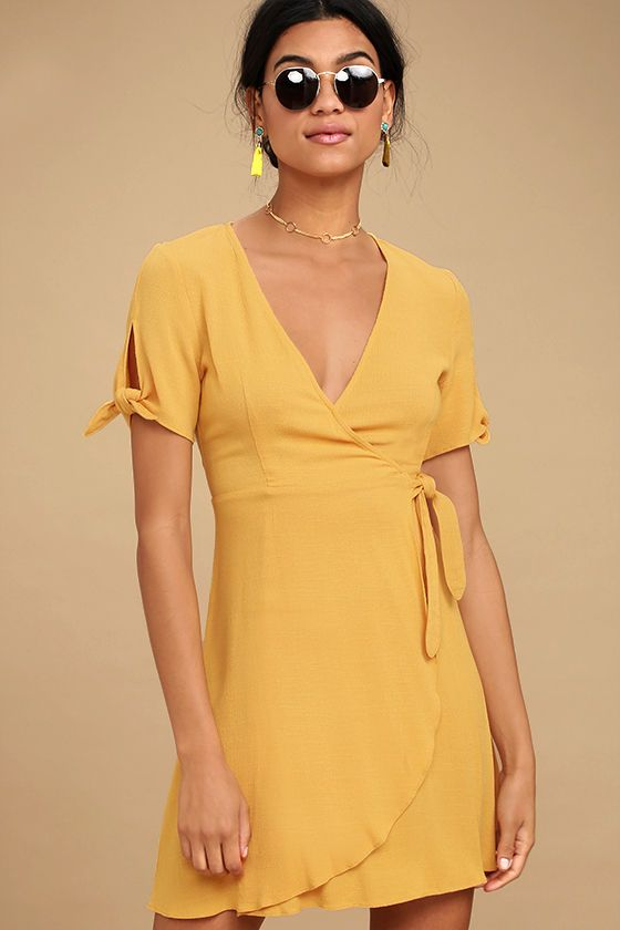 Lulus Exclusive! Make a statement all your own in the My Philosophy Golden Yellow Wrap Dress! Gauzy woven fabric sweeps across tying, short sleeves and a wrapping surplice bodice with hidden snaps and a tying waist. Lightly flared skirt falls to a flirty hem. As Seen On Marielle of @mariellelindahl!