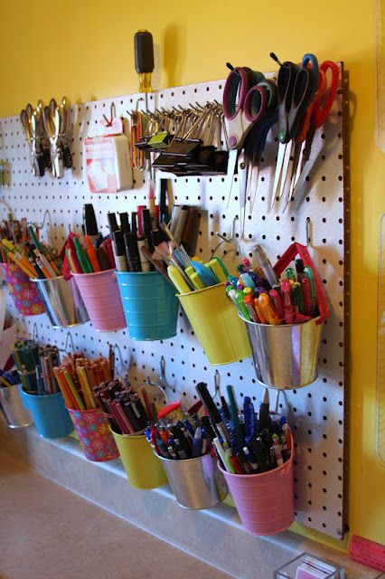 supercute and organized pegboard in Amber's studio...do I need to mention that it's sparkly?